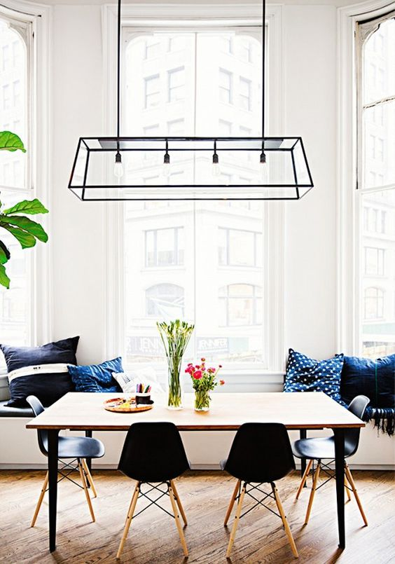 a cool black geometric lighting fixture makes a statement in this space