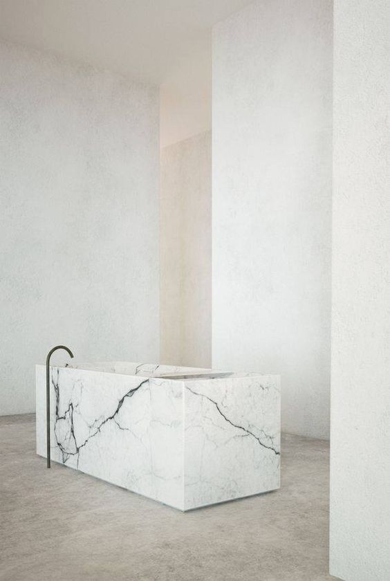 a statement square marble tub is a luxurious piece, which is enough to make your space gorgeous