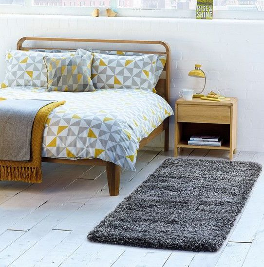 grey, white and mustard triangle print bedding for a Scandinavian space
