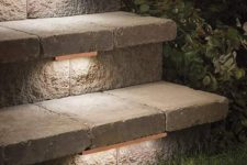 19 low-profile contemporary stair lighting under treads of outdoor stone steps