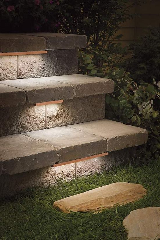 low-profile contemporary stair lighting under treads of outdoor stone steps