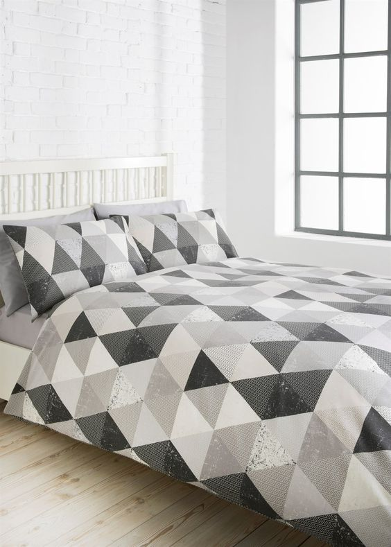 white and shades of grey geometric bedding for a peaceful feel