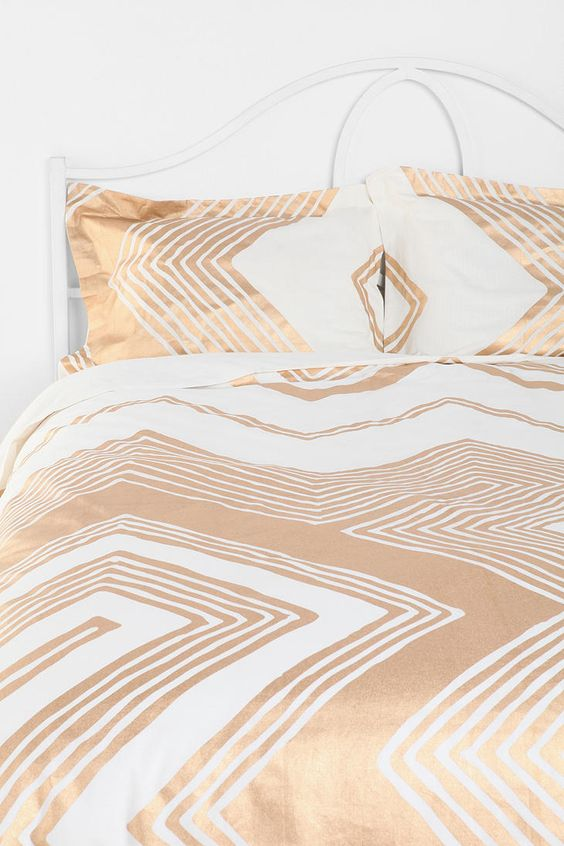 white and gold geometric large scale print bedding for a glam touch