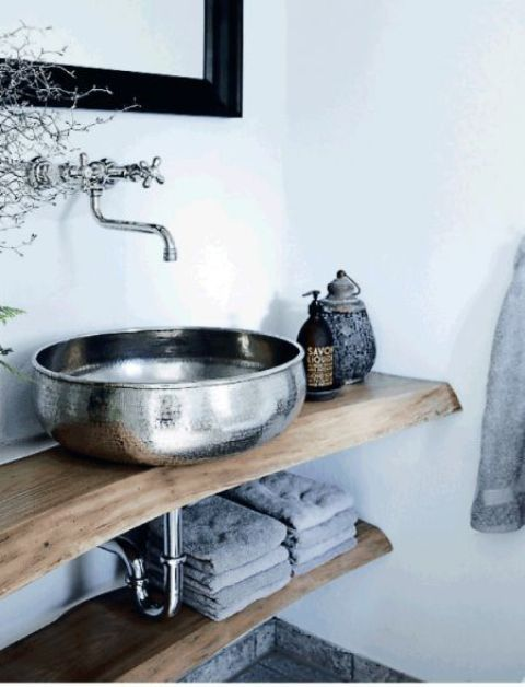 a metal sink and matching hardware contrast with wood