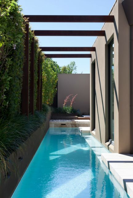 a very small backyard accomodates only a cool narrow pool for relaxing