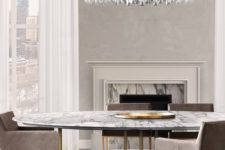 21 gorgeous oversized glam chandelier echoes with table and chair legs
