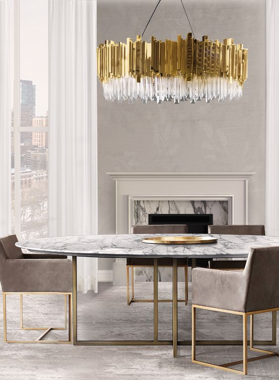 gorgeous oversized glam chandelier echoes with table and chair legs