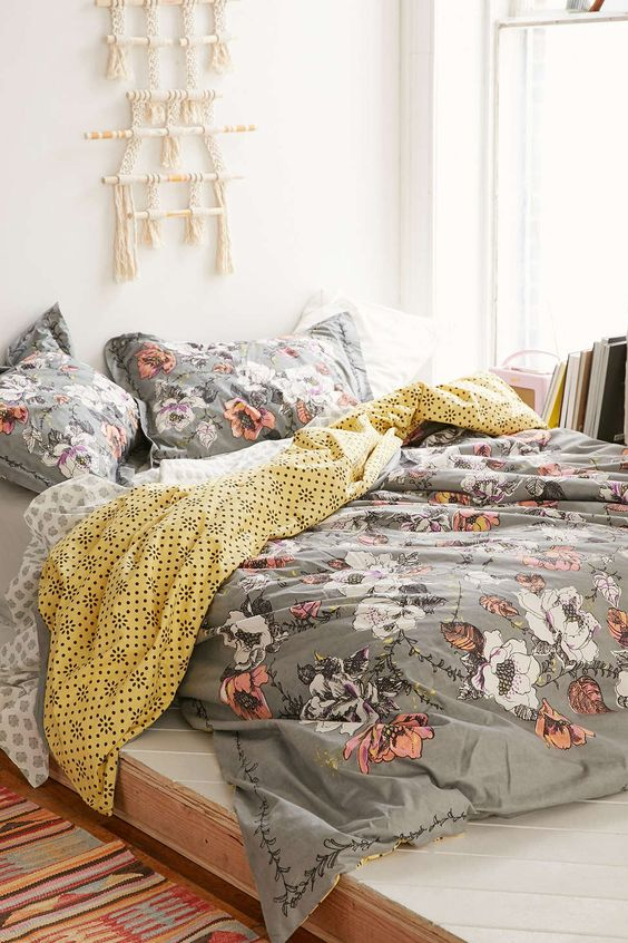 grey bedding with coral and white flowers