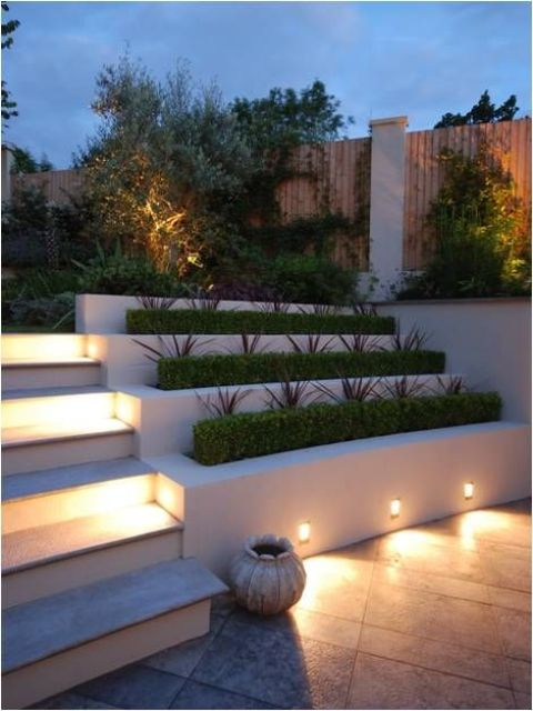 lights attached to the planters to illuminate the patio and steps