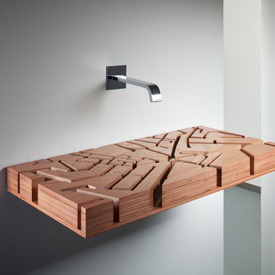 a wooden sink inspired by a map of London looks really unique