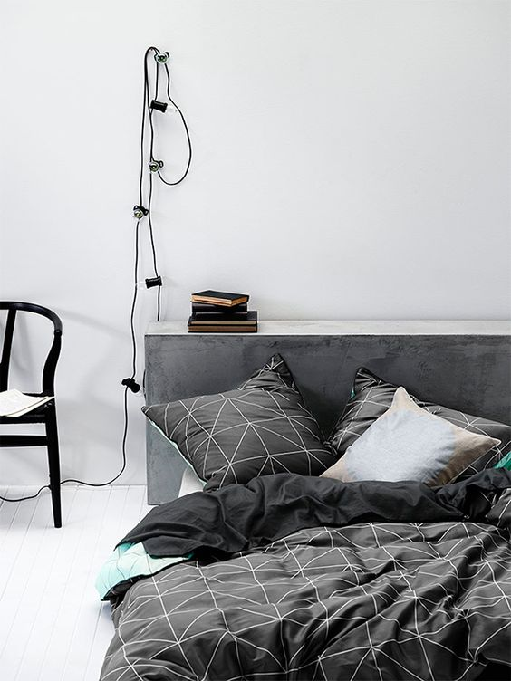 black graphic bedding with white prints for a masculine bedroom