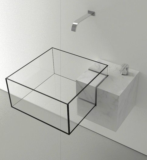 minimalist framed glass sink in a marble holder