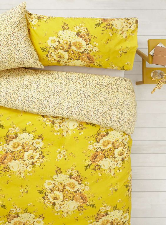 sunny yellow bedding with spotted lining and flowers in the same shades