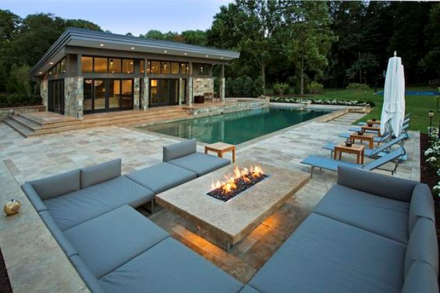 a modern lit fire pit is enough for a living zone