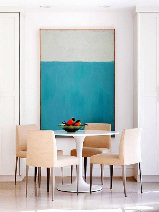 a large scale wlal art accentuates this area and adds color