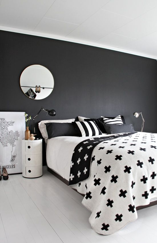 graphic black and white bedding with stripes and crosses for a minimalist space