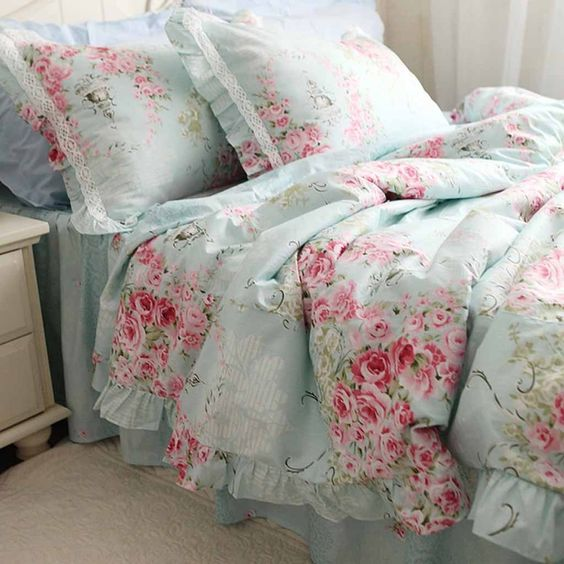 vintage-inspired blue and pink rose bedding with lace detailing