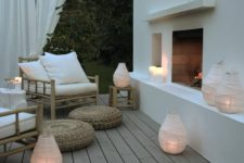 28 a fireplace and unusual fabric covered candle lanterns