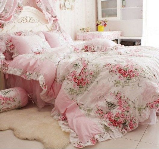 vintage-inspired pink bedding with pink flowers and greenery for a princess room