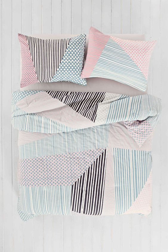 pastel blush and blue and black bedding with a graphic print for a girlish space