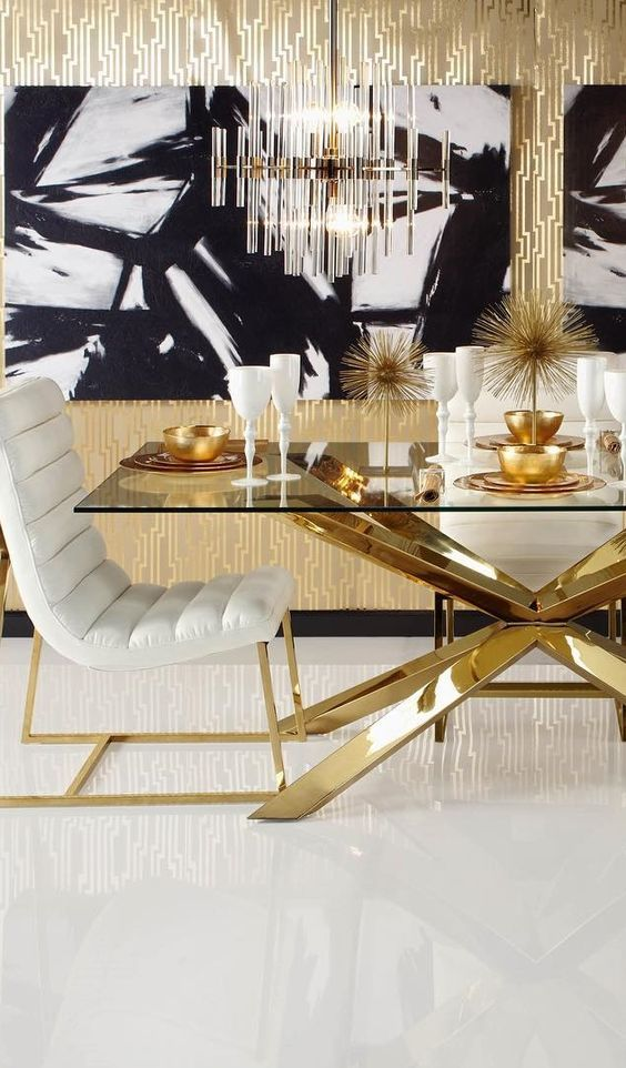 a black and white wall art makes the gold and white space calmer