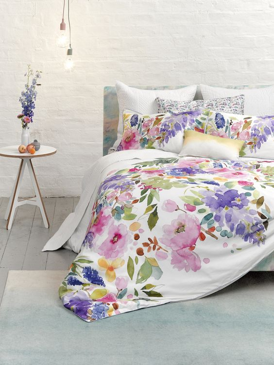 watercolor bedding in shades of pink, lilac, purple and green