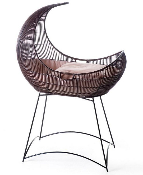 exotic moon-shaped cradle by Kenneth Cobonpue (via www.furniturefashion.com)