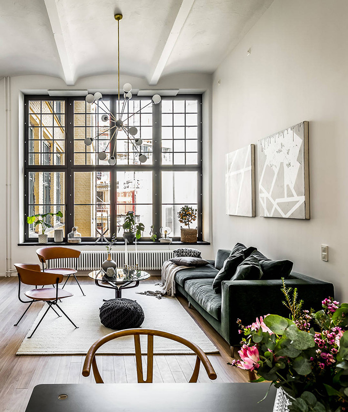 This Stockholm apartment is in a converted brewery but nothing reminds of its industrial factory as it's decorated in Scandinavian apartment