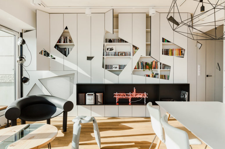 This modern penthouse features many cool designer solutions, and asymmetric wall panels are among them