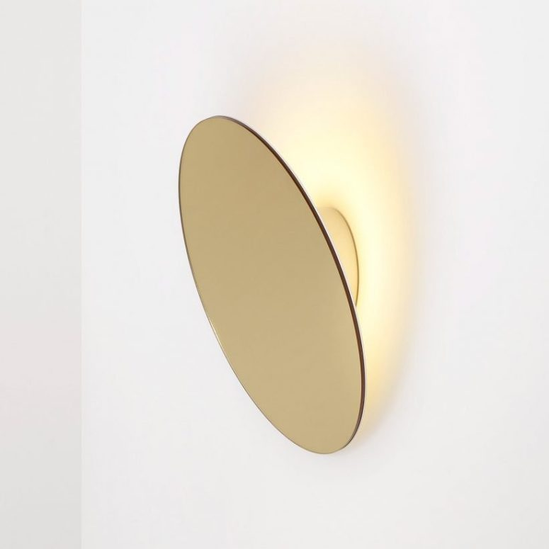 Its disc is lit from behind and creates circles of light that resemble the