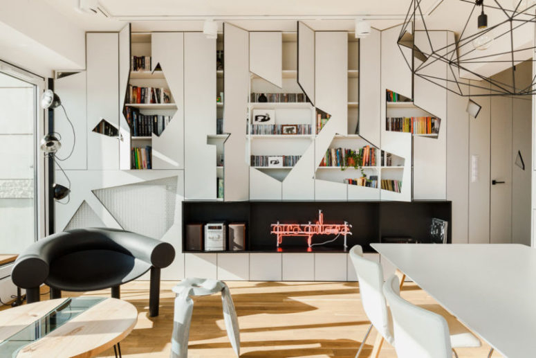 The cabinets received unique cutout front panels that highlighted the style of the apartment and gave it more personality