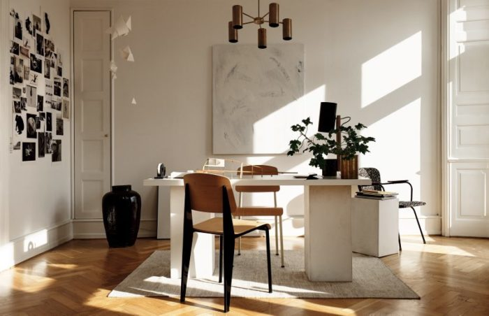 The home office looks like a canvas for all types of creations, and a black and white photo collage inspires the owner