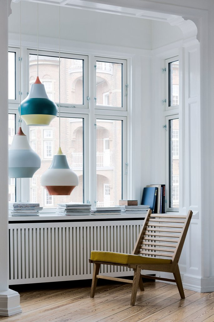 These are large hanging lamps with colorful stripes that are to raise your mood