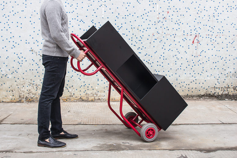 This pushcart furniture piece can be used as a coffee table as well as a bookshelf when upright