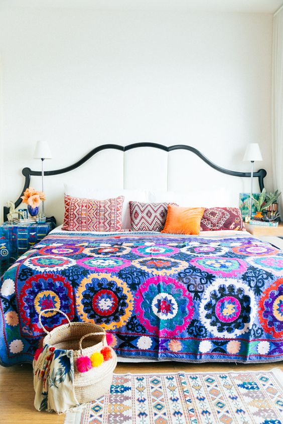 bold print bedspread and geo printed pillows to pair with