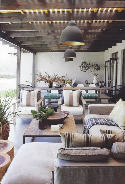 an outdoor space in modern and Scandinavian style including a living room and a dining room