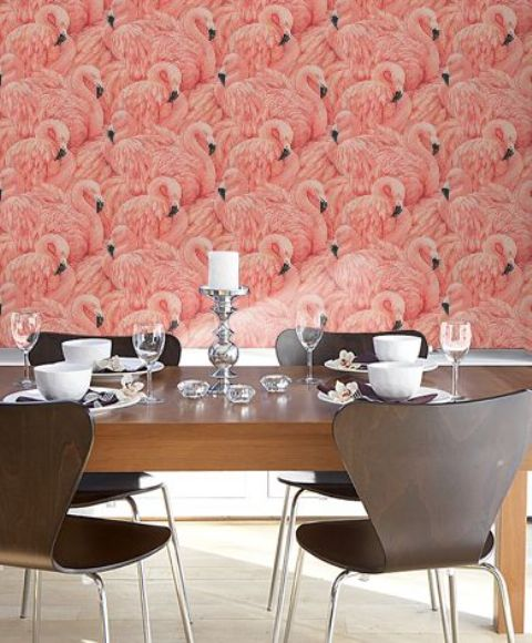 pink flamingo wallpaper make this modern dining space pop with color