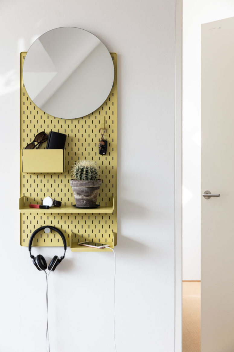 Frame is a colorful storage piece with a mirror, it's ideal for storing small things and accessories