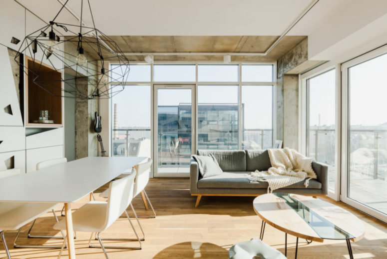 The sofa nook gets the views and light from all around, and there are two doors to reach the balcony