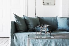 04 There are some colorful touches done with furniture, for example, this dusty blue sofa with pillows, which perfectly accentuates the space