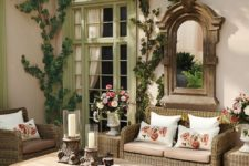 04 a patio that resembles a traditional living room with vintage touches and rustic furniture