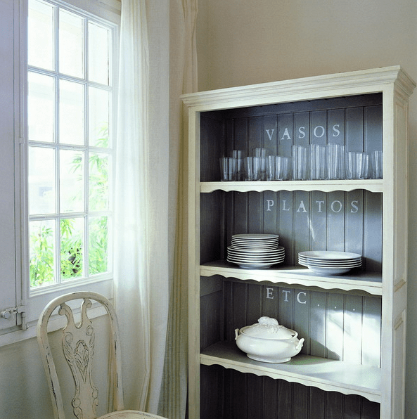 pastel green cupboard with no glass and dark grey inside for a contrast