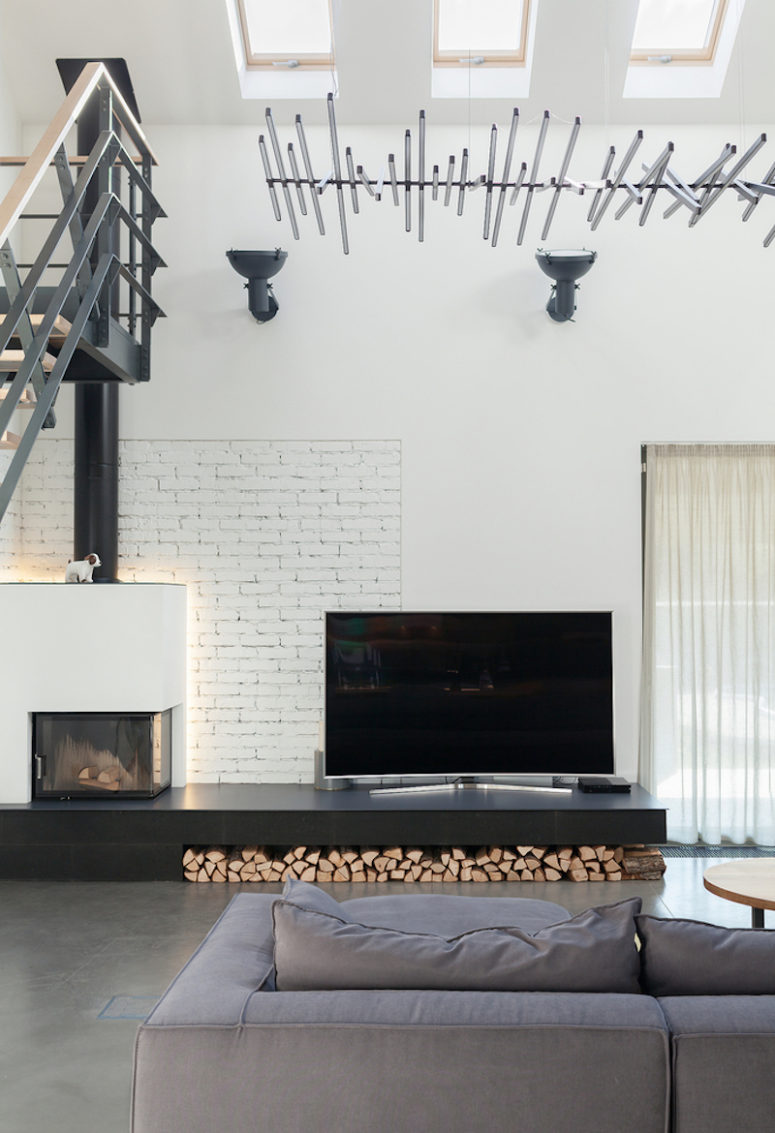 Metal, whitewashed brick, firewood and concrete add texture to the decor