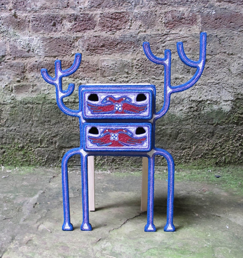 The Maxa jewelry box in bold blue and red looks alien-like