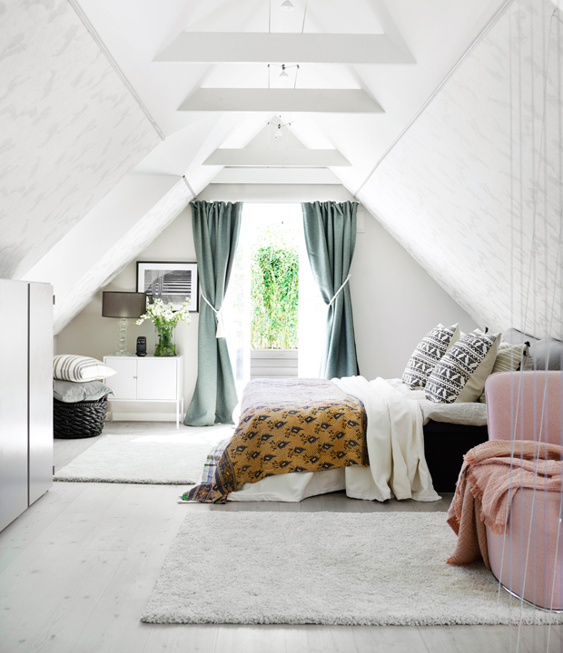 The master bedroom is an attic space, which is a great calming backdrop for bold and printed fabrics