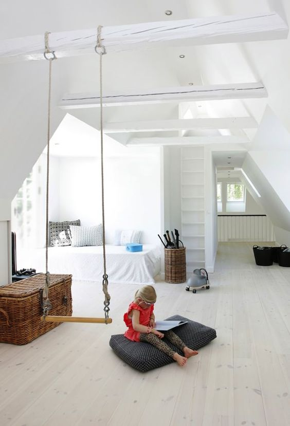 a swing can serve an additional space divider in a kid's room