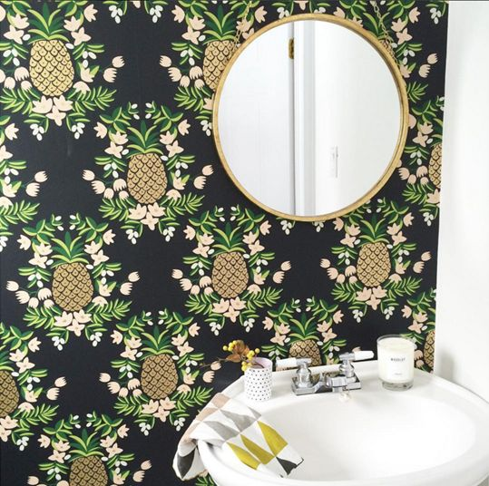 black wallpaper with pineapple and floral prints