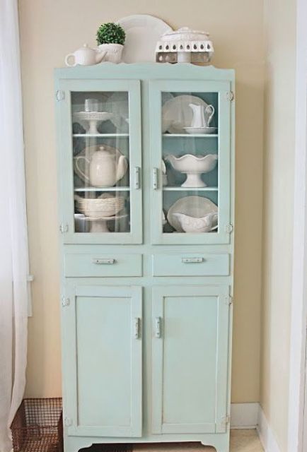 dusty blue cupboard with glass and usual compartments will accentuate any vintage space