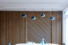 05 wood planks clad in a geometric pattern create bold decor and make the space cool