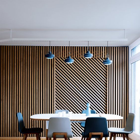 wood planks clad in a geometric pattern create bold decor and make the space cool